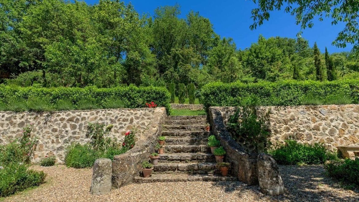 Rolling Hills Italy - Ancient mill for sale in San Gimignano in Tuscany.